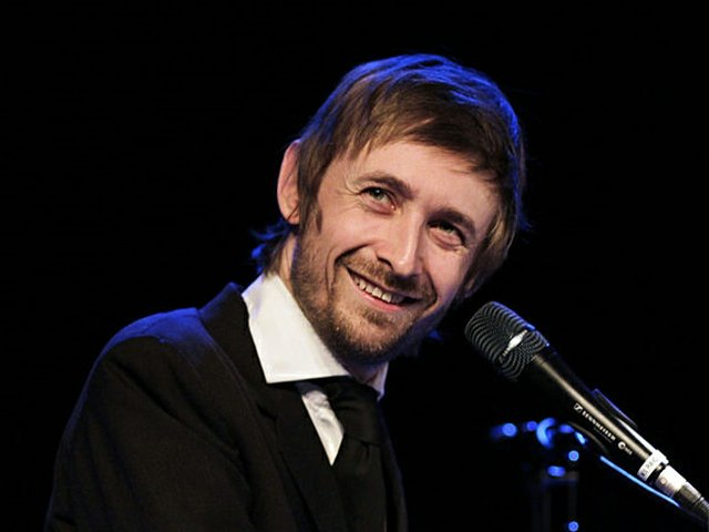 the-divine-comedy-band-pop-music-uk-singer-neil-hannon-performing-at-picture-id548150005.jpg