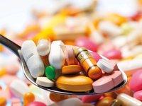 Tabletten auf Löffel